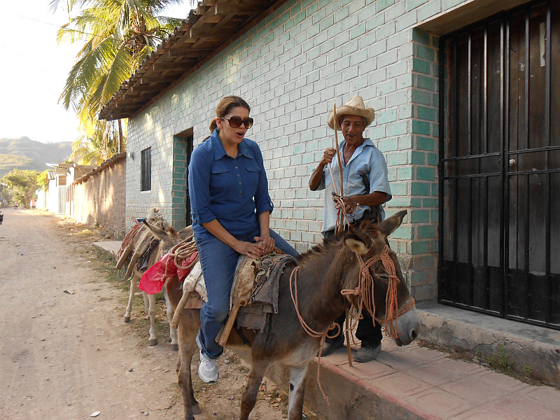 Laura rides donkey in Reitoca