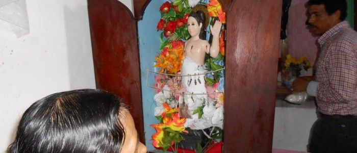 43 - Woman looks at St.Sebastian in Azacualpa - 1-9-2013