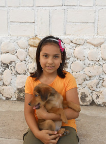 Girl holds puppy